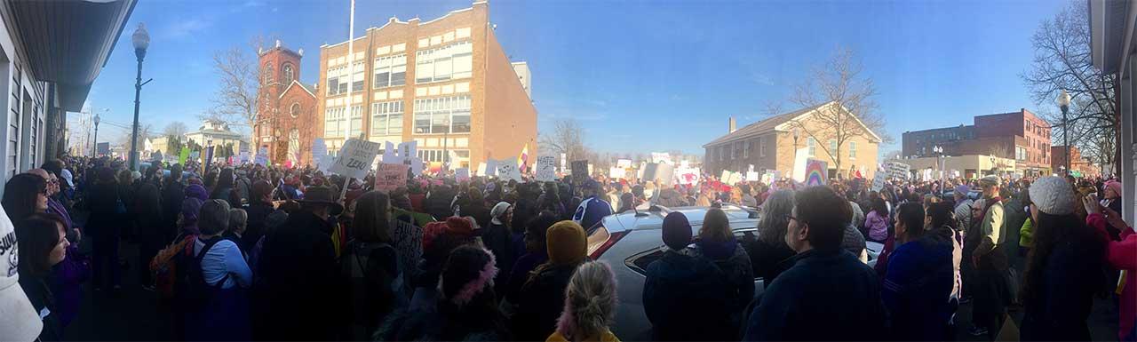 Women March in Seneca Falls panorama (photo)